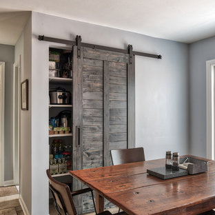 Mid-sized industrial eat-in kitchen ideas - Inspiration for a mid-sized industrial l-shaped ceramic tile and brown floor eat-in kitchen remodel in New York with an undermount sink, beaded inset cabinets, medium tone wood cabinets, granite countertops, gray backsplash, slate backsplash, stainless steel appliances and an island