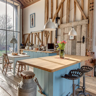 Design Ideas For A Rustic Kitchen In Other With Blue Cabinets