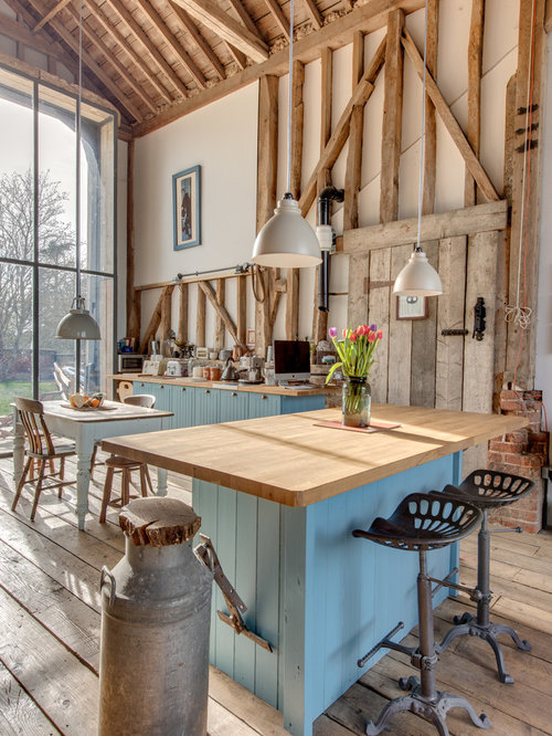 Design Ideas For A Rustic Kitchen With Blue Cabinets.