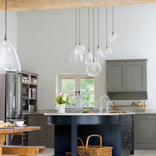Inspiration for a country u-shaped kitchen/diner in Gloucestershire with shaker cabinets, grey cabinets, stainless steel appliances, a breakfast bar and grey floors.