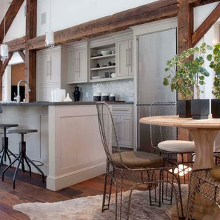 Farmhouse eat-in kitchen ideas - Eat-in kitchen - country eat-in kitchen idea in New York with shaker cabinets, gray cabinets, metallic backsplash and stainless steel appliances