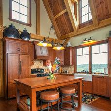 Farmhouse Kitchen by Oakbridge Timberframing