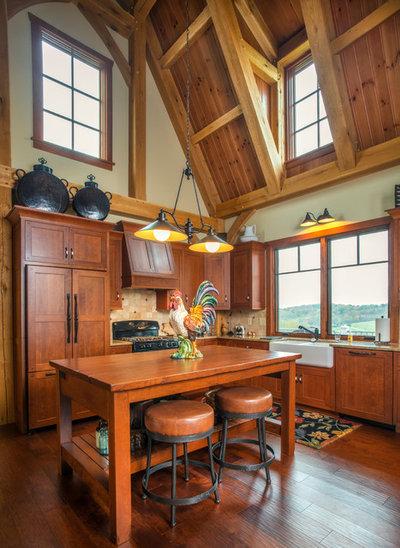 Farmhouse Kitchen by Oakbridge Timberframing
