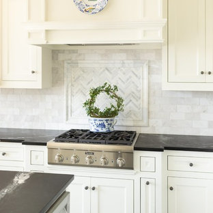 Small traditional l-shaped eat-in kitchen in Little Rock with a single-bowl sink, flat-panel cabinets, white cabinets, soapstone benchtops, white splashback, marble splashback, panelled appliances, concrete floors, with island, grey floor and green benchtop.
