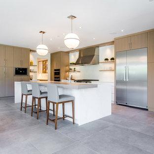 Ispirazione per una grande cucina moderna con lavello sottopiano, ante lisce, ante in legno scuro, top in quarzite, paraspruzzi bianco, paraspruzzi in lastra di pietra, elettrodomestici in acciaio inossidabile, pavimento in cementine, isola, pavimento grigio e top bianco