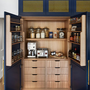 Photo of a transitional kitchen in Melbourne with blue cabinets.
