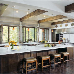 Large transitional eat-in kitchen photos - Example of a large transitional l-shaped dark wood floor and brown floor eat-in kitchen design in Chicago with dark wood cabinets, white backsplash, stainless steel appliances, an island and shaker cabinets