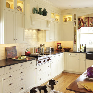 This is an example of a traditional kitchen in Boston with shaker cabinets, metro tiled splashback, white cabinets, soapstone worktops, white splashback and stainless steel appliances.