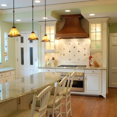Example of a classic kitchen design in Chicago with raised-panel cabinets, white cabinets, multicolored backsplash and stainless steel appliances