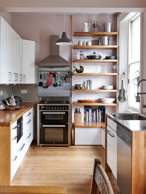 Design Ideas For Small Kitchens small kitchen design ideas stylecaster cabinets that go all the way to the ceiling Small Contemporary Kitchen Idea In London With Flat Panel Cabinets White Cabinets Wood