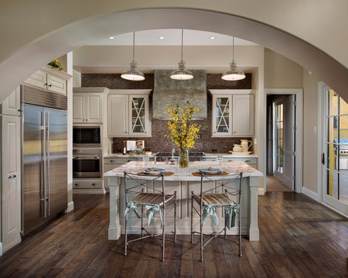 Transitional galley kitchen idea in Phoenix with raised-panel cabinets,  white cabinets, brown - Distressed Wood Floors Houzz