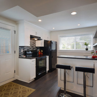 Example of a trendy kitchen design in Vancouver with black appliances