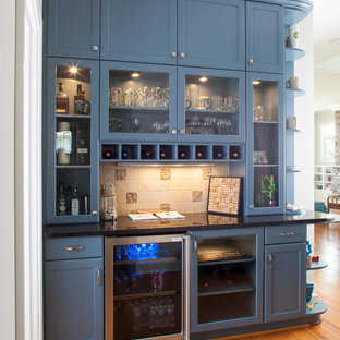 Mid-sized traditional kitchen remodeling - Kitchen - mid-sized traditional medium tone wood floor and brown floor kitchen idea in Detroit with recessed-panel cabinets, gray cabinets, beige backsplash, ceramic backsplash and stainless steel appliances