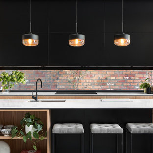 Inspiration for a contemporary kitchen in Melbourne with a double-bowl sink, flat-panel cabinets, light wood cabinets and with island.