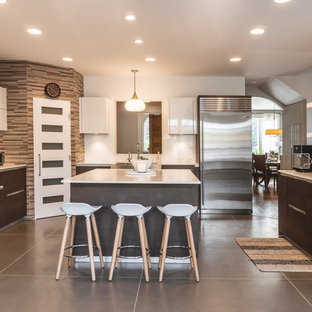 Contemporary enclosed kitchen ideas - Inspiration for a contemporary u-shaped concrete floor and gray floor enclosed kitchen remodel in Portland with flat-panel cabinets, dark wood cabinets, brown backsplash, matchstick tile backsplash, stainless steel appliances and an island