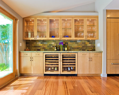 Modern kitchen idea in San Francisco with glass-front cabinets, medium ...