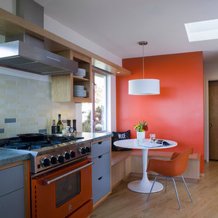Design ideas for a contemporary kitchen in San Francisco with open cabinets, multi-coloured splashback and coloured appliances.