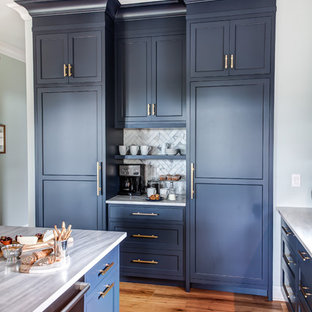 Inspiration for a large classic l-shaped kitchen/diner in New York with a submerged sink, recessed-panel cabinets, blue cabinets, granite worktops, multi-coloured splashback, porcelain splashback, stainless steel appliances, medium hardwood flooring, an island, brown floors and grey worktops.