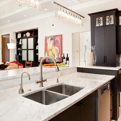 Example of a trendy kitchen design in Miami with a double-bowl sink, marble countertops, flat-panel cabinets and dark wood cabinets
