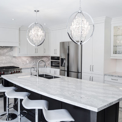 Inspiration for a large transitional l-shaped porcelain tile and gray floor enclosed kitchen remodel in Toronto with shaker cabinets, white cabinets, quartz countertops, stainless steel appliances, an island, a double-bowl sink and gray backsplash