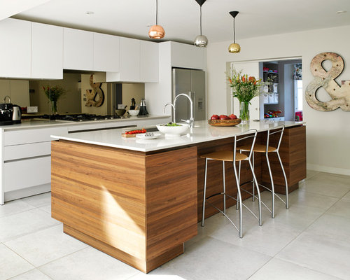 Trendy L Shaped Kitchen Photo In London With An Island, Flat Panel Cabinets