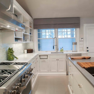 Eat-in kitchen - large beach style u-shaped ceramic floor eat-in kitchen idea in Other with an undermount sink, shaker cabinets, white cabinets, quartz countertops, white backsplash, stainless steel appliances and an island