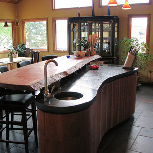 Design ideas for an expansive beach style u-shaped open plan kitchen in Seattle with an undermount sink, flat-panel cabinets, medium wood cabinets, concrete benchtops, grey splashback, ceramic splashback, stainless steel appliances, ceramic floors and with island.