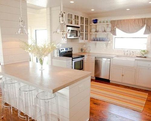 cottage kitchen lighting. example of a coastal ushaped kitchen design in houston with farmhouse sink cottage lighting