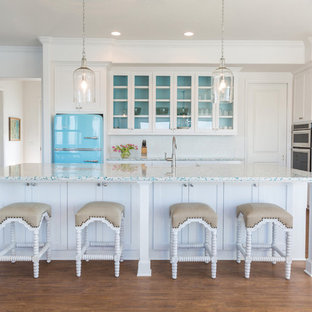 Kitchen - beach style kitchen idea in Houston with an island and colored appliances