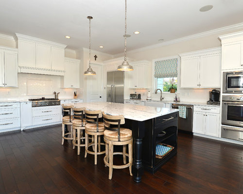 Example Of A Coastal L Shaped Dark Wood Floor Open Concept Kitchen Design  In Tampa