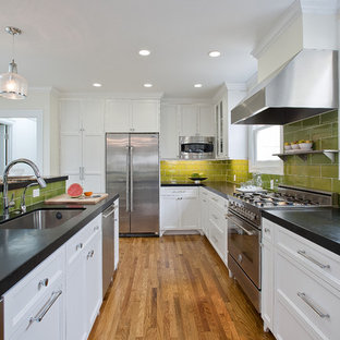 Kitchen - beach style kitchen idea in San Francisco with recessed-panel cabinets, stainless steel appliances, an undermount sink, white cabinets, green backsplash and subway tile backsplash