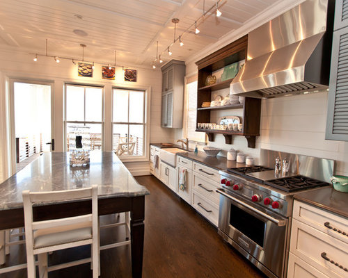 beach style kitchen idea in raleigh with stainless steel appliances