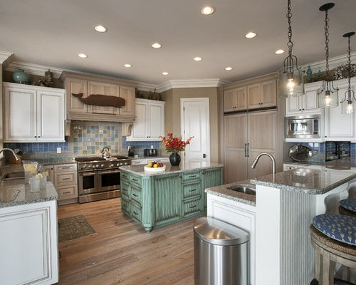 inspiration for a beach style u shaped kitchen remodel in other with raised panel - Beach Kitchen Ideas