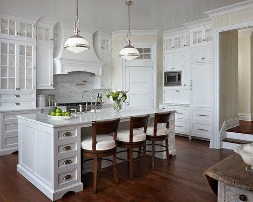 Mid-sized beach style u-shaped kitchen pantry idea with a farmhouse ...