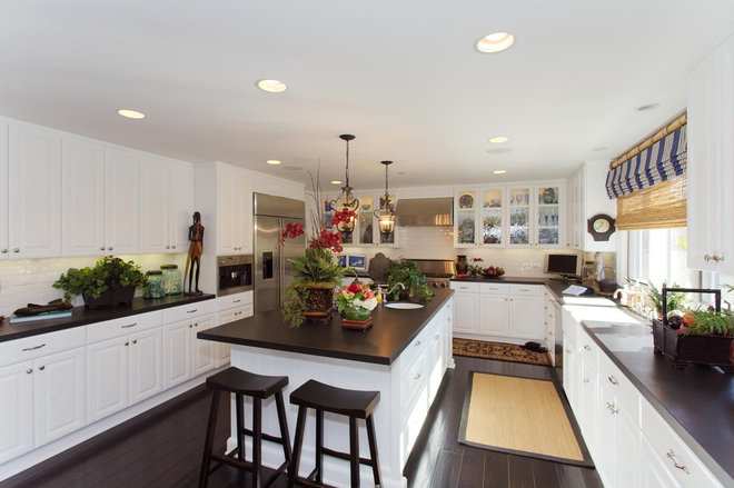Beach Style Kitchen by Premier Home Staging and Interiors, LLC