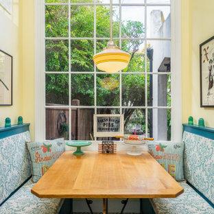 ロサンゼルスの小さいカントリー風おしゃれなキッチン (エプロンフロントシンク、インセット扉のキャビネット、青いキャビネット、クオーツストーンカウンター、黄色いキッチンパネル、サブウェイタイルのキッチンパネル、白い調理設備、セメントタイルの床、青い床、白いキッチンカウンター) の写真