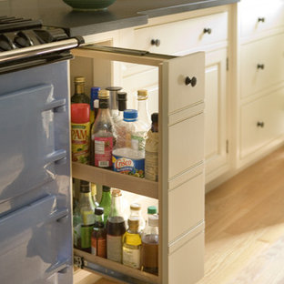 Traditional kitchen appliance - Example of a classic light wood floor kitchen design in Boston