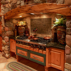 Rustic Kitchen by Quilter Construction & Remodeling