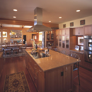 Craftsman open concept kitchen pictures - Inspiration for a craftsman u-shaped open concept kitchen remodel in Denver with shaker cabinets, medium tone wood cabinets and stainless steel appliances