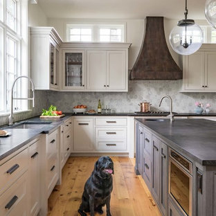 Design ideas for a large transitional l-shaped kitchen in Boston with white cabinets, soapstone benchtops, grey splashback, ceramic splashback, stainless steel appliances, medium hardwood floors, a single-bowl sink, shaker cabinets and with island.