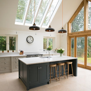 Design ideas for a large country kitchen/diner in Surrey with shaker cabinets, quartz worktops, an island, a submerged sink, grey cabinets, grey splashback, stainless steel appliances, beige floors and white worktops.