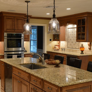 Traditional kitchen designs - Kitchen - traditional kitchen idea in New York with stainless steel appliances and granite countertops