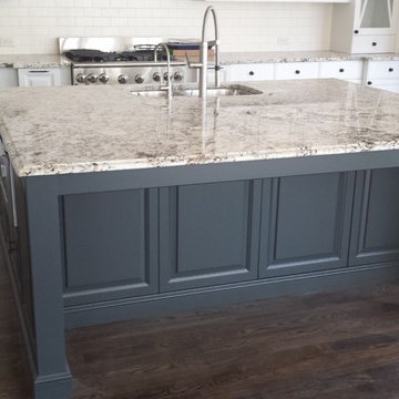 Beautiful White Granite On Large Island with Darker Cabinets