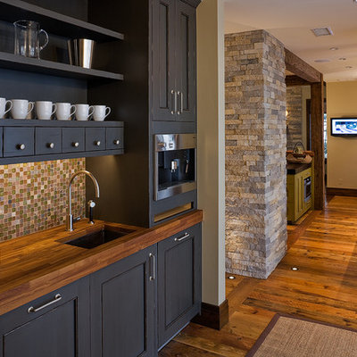 Mountain style kitchen photo in Denver with mosaic tile backsplash, wood countertops, multicolored backsplash, gray cabinets, recessed-panel cabinets and an undermount sink