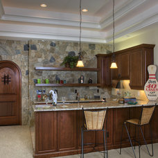 Rustic Kitchen by Grainda Builders, Inc.