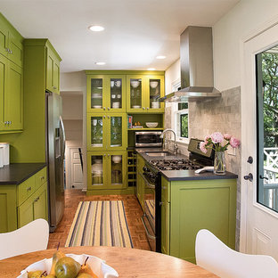 Design ideas for a small midcentury galley eat-in kitchen in Other with an undermount sink, shaker cabinets, green cabinets, laminate benchtops, grey splashback, stone tile splashback, stainless steel appliances and medium hardwood floors.