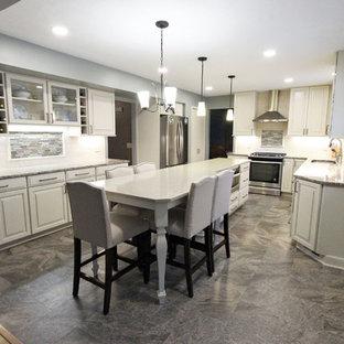 Beige Kitchen with Extra Large Island, Tile Backsplash and Granite Countertops