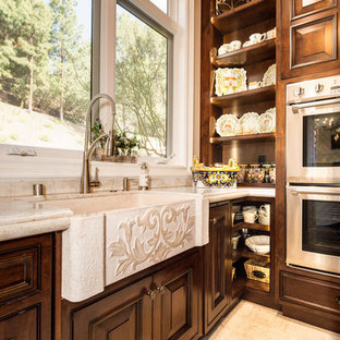Huge traditional enclosed kitchen ideas - Inspiration for a huge timeless u-shaped medium tone wood floor and brown floor enclosed kitchen remodel in Los Angeles with stainless steel appliances and two islands