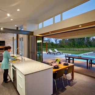 Modern eat-in kitchen designs - Eat-in kitchen - modern galley eat-in kitchen idea in Cincinnati with an undermount sink, flat-panel cabinets, white cabinets, stainless steel appliances and granite countertops