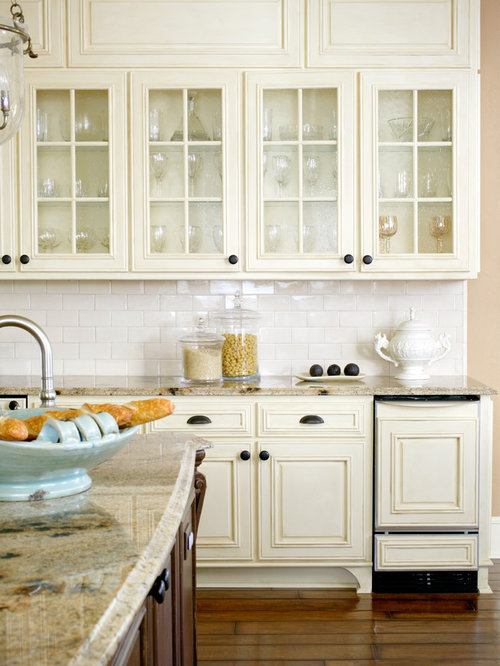 Elegant kitchen photo in Little Rock with glass-front cabinets, white  cabinets, white - Antique White Cabinets Houzz